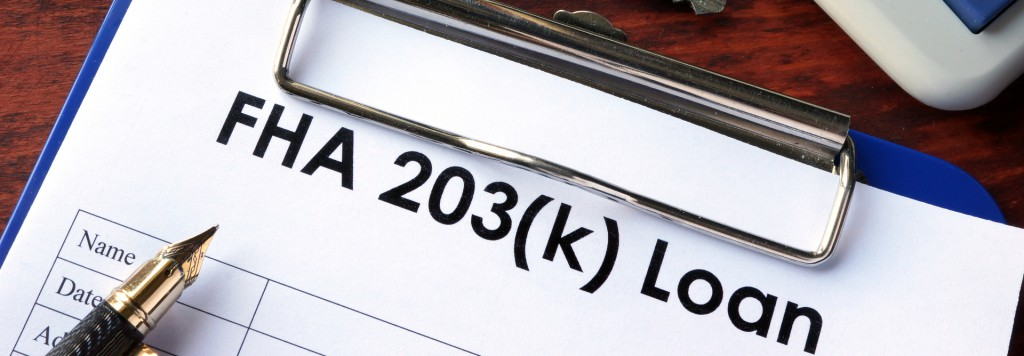 FHA 203(k) Loan on a clip board with a fountain pen and a set of keys next to a calculator