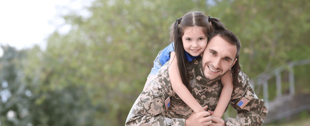 happy soldier with daughter